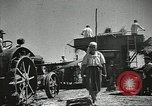 Image of Soviet farmers cutting and threshing stalks of grain during World War 2 Soviet Union, 1941, second 19 stock footage video 65675062264