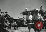Image of Soviet farmers cutting and threshing stalks of grain during World War 2 Soviet Union, 1941, second 20 stock footage video 65675062264