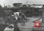 Image of Devastation from Japanese attack on Pearl Harbor Pearl Harbor Hawaii USA, 1941, second 51 stock footage video 65675062272