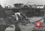 Image of Devastation from Japanese attack on Pearl Harbor Pearl Harbor Hawaii USA, 1941, second 52 stock footage video 65675062272
