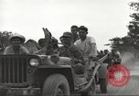 Image of Americans rescued from Japanese prison camp ride in trucks Luzon Island Philippines, 1945, second 18 stock footage video 65675062322