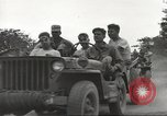 Image of Americans rescued from Japanese prison camp ride in trucks Luzon Island Philippines, 1945, second 23 stock footage video 65675062322