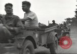 Image of Americans rescued from Japanese prison camp ride in trucks Luzon Island Philippines, 1945, second 24 stock footage video 65675062322