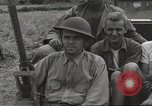 Image of Americans rescued from Japanese prison camp ride in trucks Luzon Island Philippines, 1945, second 26 stock footage video 65675062322