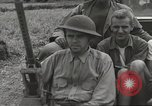 Image of Americans rescued from Japanese prison camp ride in trucks Luzon Island Philippines, 1945, second 30 stock footage video 65675062322