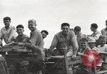 Image of Americans rescued from Japanese prison camp ride in trucks Luzon Island Philippines, 1945, second 47 stock footage video 65675062322