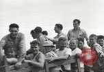 Image of Americans rescued from Japanese prison camp ride in trucks Luzon Island Philippines, 1945, second 48 stock footage video 65675062322