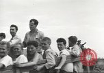 Image of Americans rescued from Japanese prison camp ride in trucks Luzon Island Philippines, 1945, second 49 stock footage video 65675062322