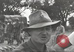 Image of Americans rescued from Japanese prison camp ride in trucks Luzon Island Philippines, 1945, second 54 stock footage video 65675062322