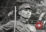 Image of Japanese soldiers Philippines, 1942, second 50 stock footage video 65675062369