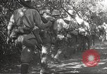 Image of Japanese Infantry marching into Philippines Philippines, 1942, second 24 stock footage video 65675062373