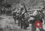 Image of Japanese Infantry marching into Philippines Philippines, 1942, second 60 stock footage video 65675062373