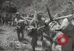 Image of Japanese Infantry marching into Philippines Philippines, 1942, second 61 stock footage video 65675062373