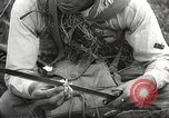 Image of Japanese infantrymen Bataan Luzon Philippines, 1942, second 57 stock footage video 65675062389