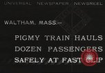 Image of Children ride on train pulled by small locomotive Waltham Massachusetts USA, 1932, second 1 stock footage video 65675062519