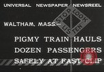 Image of Children ride on train pulled by small locomotive Waltham Massachusetts USA, 1932, second 2 stock footage video 65675062519