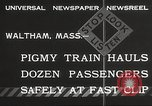 Image of Children ride on train pulled by small locomotive Waltham Massachusetts USA, 1932, second 5 stock footage video 65675062519