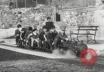 Image of Children ride on train pulled by small locomotive Waltham Massachusetts USA, 1932, second 18 stock footage video 65675062519