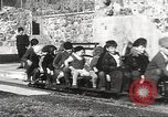 Image of Children ride on train pulled by small locomotive Waltham Massachusetts USA, 1932, second 20 stock footage video 65675062519