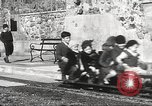 Image of Children ride on train pulled by small locomotive Waltham Massachusetts USA, 1932, second 21 stock footage video 65675062519