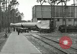 Image of A-4 missile towed for simulated launch at Test Stand 5 Peenemunde Germany, 1943, second 15 stock footage video 65675062547