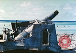 Image of Japanese coastal defense gun Tarawa Gilbert Islands, 1944, second 2 stock footage video 65675062569