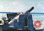 Image of Japanese coastal defense gun Tarawa Gilbert Islands, 1944, second 4 stock footage video 65675062569