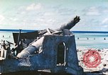 Image of Japanese coastal defense gun Tarawa Gilbert Islands, 1944, second 5 stock footage video 65675062569