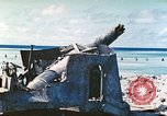 Image of Japanese coastal defense gun Tarawa Gilbert Islands, 1944, second 6 stock footage video 65675062569