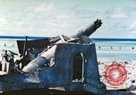 Image of Japanese coastal defense gun Tarawa Gilbert Islands, 1944, second 8 stock footage video 65675062569