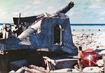 Image of Japanese coastal defense gun Tarawa Gilbert Islands, 1944, second 15 stock footage video 65675062569