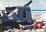 Image of Japanese coastal defense gun Tarawa Gilbert Islands, 1944, second 16 stock footage video 65675062569
