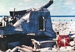 Image of Japanese coastal defense gun Tarawa Gilbert Islands, 1944, second 18 stock footage video 65675062569