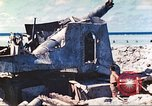 Image of Japanese coastal defense gun Tarawa Gilbert Islands, 1944, second 22 stock footage video 65675062569