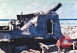Image of Japanese coastal defense gun Tarawa Gilbert Islands, 1944, second 24 stock footage video 65675062569