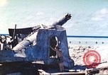 Image of Japanese coastal defense gun Tarawa Gilbert Islands, 1944, second 26 stock footage video 65675062569