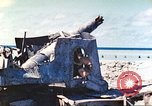 Image of Japanese coastal defense gun Tarawa Gilbert Islands, 1944, second 29 stock footage video 65675062569