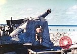 Image of Japanese coastal defense gun Tarawa Gilbert Islands, 1944, second 31 stock footage video 65675062569