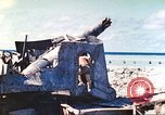 Image of Japanese coastal defense gun Tarawa Gilbert Islands, 1944, second 32 stock footage video 65675062569