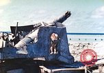 Image of Japanese coastal defense gun Tarawa Gilbert Islands, 1944, second 33 stock footage video 65675062569