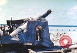 Image of Japanese coastal defense gun Tarawa Gilbert Islands, 1944, second 35 stock footage video 65675062569