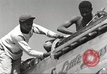 Image of Ground crewmwn servicing P-51s of the 332nd Fighter Group Termoli Italy, 1944, second 14 stock footage video 65675062602