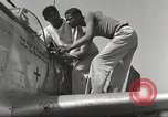 Image of Ground crewmwn servicing P-51s of the 332nd Fighter Group Termoli Italy, 1944, second 39 stock footage video 65675062602