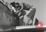 Image of Ground crewmwn servicing P-51s of the 332nd Fighter Group Termoli Italy, 1944, second 41 stock footage video 65675062602