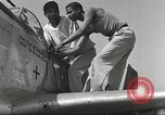 Image of Ground crewmwn servicing P-51s of the 332nd Fighter Group Termoli Italy, 1944, second 44 stock footage video 65675062602