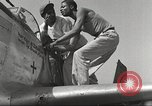 Image of Ground crewmwn servicing P-51s of the 332nd Fighter Group Termoli Italy, 1944, second 45 stock footage video 65675062602