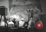 Image of 332nd Fighter Group pilots being briefed before mission Termoli Italy, 1944, second 38 stock footage video 65675062608
