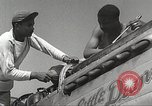 Image of Ground Crewmen of 332nd Fighter Group maintain P-51s Termoli Italy, 1944, second 18 stock footage video 65675062615