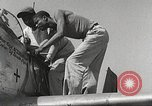 Image of Ground Crewmen of 332nd Fighter Group maintain P-51s Termoli Italy, 1944, second 41 stock footage video 65675062615