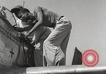 Image of Ground Crewmen of 332nd Fighter Group maintain P-51s Termoli Italy, 1944, second 42 stock footage video 65675062615